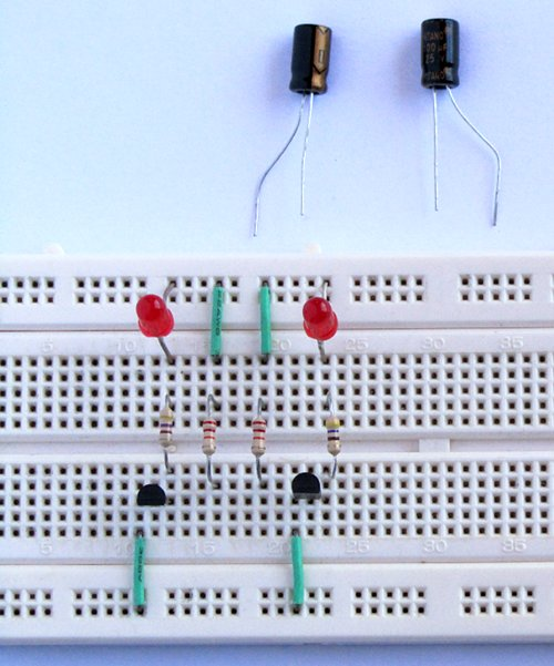 tutorial 8 dual led flasher circuit for beginners in electronicsinsert the capacitors with the positive lead of each capacitor on the collector of its corresponding transistor connect the negative lead of each capacitor